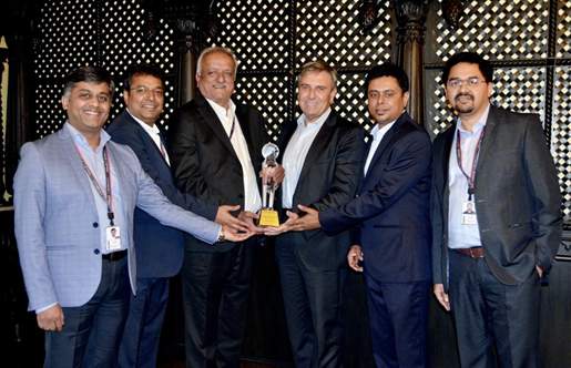 Mohammed M. Ajouz (center) presents the ACE Alliance Award to the Birlasoft team